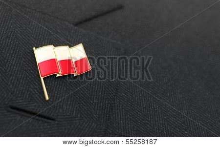 Poland Flag Lapel Pin On The Collar Of A Business Suit