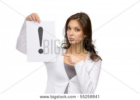 Half-length portrait of woman pointing at the exclamatory mark she hands, isolated on white. Concept of problem and solution