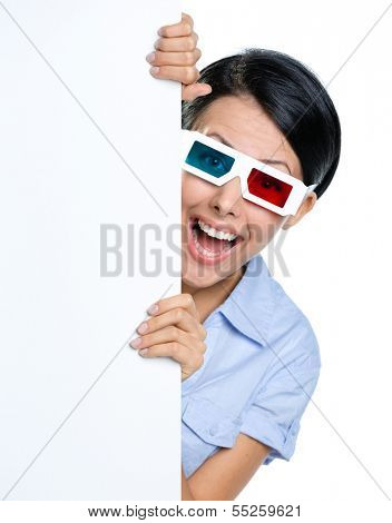 Viewer in 3D spectacles peeps out from behind the copyspace, isolated on white