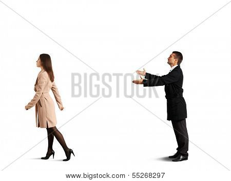sad young man calling outgoing woman. isolated on white background