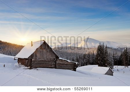 Winter landscape in the early morning. Hut in a mountain valley. Carpathian mountains, Ukraine, Europe
