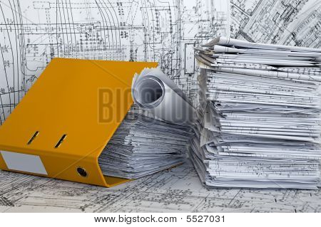 Heap Of Project Drawings In Yellow Folder