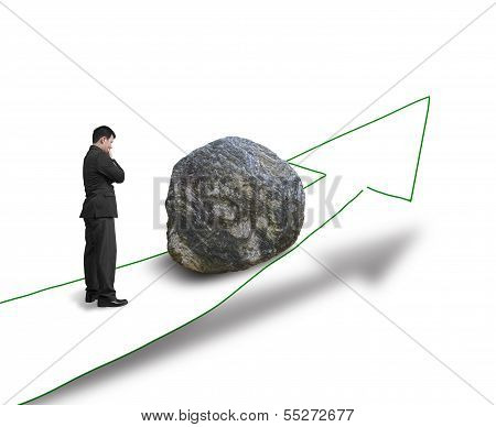 Businessman Thinking And Standing Against Large Rock On The Way
