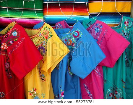 Mexican traditional market dresses and wool sarapes