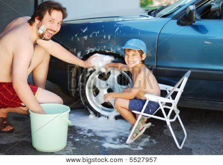 Child Washing Car And Toy Car With His Father