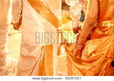 backside view of a wedding couple