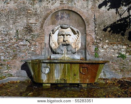 Santa Sabina, Mask Fountain In Rome , Italy