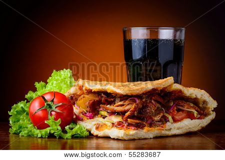 Kebab, Vegetables And Cola Drink