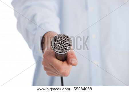 Man Holding A Retro Microphone Towards The Camera