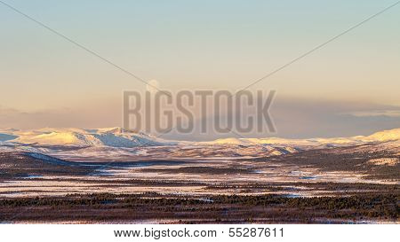 Morning Moonrise Over Mountains In Northern Sweden