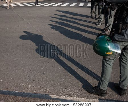 Riot Police's Shadows On The Ground  In Milan, Italy