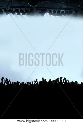 Silhouette Of Cheering Concert Crowd