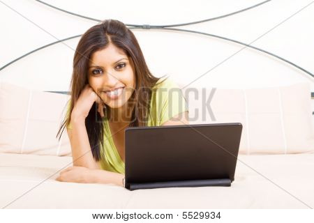 woman using laptop computer on bed
