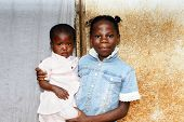 image of overpopulation  - Two black African girls - JPG