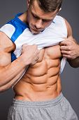 stock photo of jock  - The beautiful and strong young muscular guy - JPG
