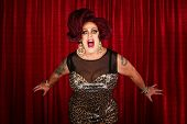 picture of drag-queen  - Drag queen screaming or singing in theater - JPG