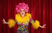 stock photo of cross-dress  - Big drag queen performing a song in theater - JPG