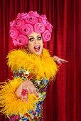 picture of drag-queen  - Happy dancing drag queen in pink foam wig - JPG