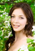 pic of nearly nude  - Portrait of pretty woman near the blossomed tree in the park - JPG