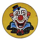 stock photo of clown face  - Vintage Tin Clown Printed Round Noisemaker over white - JPG