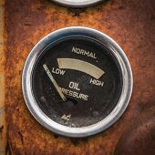 foto of vacuum pump  - An old retro steampunk style oil pressure gauge - JPG