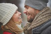 stock photo of sweethearts  - Portrait of happy guy and his girlfriend looking at one another - JPG
