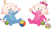 stock photo of twin baby girls  - Twin Baby Boy And Girl playing with rattles - JPG