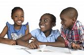 pic of three sisters  - Three african kids learning together Studio Shot - JPG