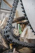 foto of grease  - old chain with grease on propel roller for motor powered - JPG