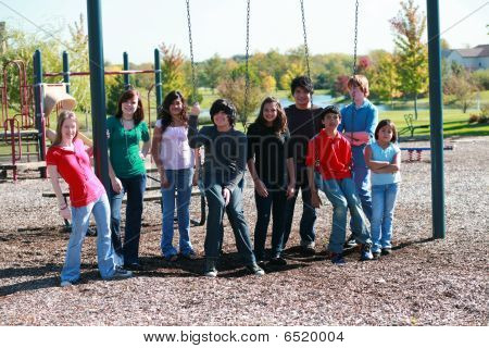 Group Of Teens On Swingset