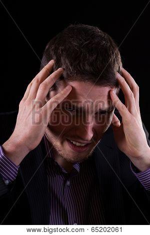 Businessman Feeling Migraine