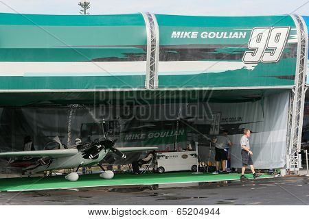 PUTRAJAYA, MALAYSIA - MAY 16, 2014: Unidentified mechanics from Mike Goulian's hangar prepare his plane for a training session during the Red Bull Air Race World Championship Putrajaya 2014.