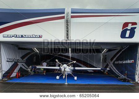 PUTRAJAYA, MALAYSIA - MAY 17, 2014: The Edge 540 V3 plane of Martin Sonka of Czech Republic parks at the hangar during the Red Bull Air Race World Championship 2014 in Putrajaya, Malaysia.