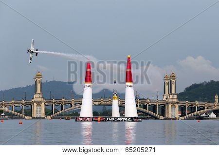 PUTRAJAYA, MALAYSIA - MAY 17, 2014: Michael Goulain from the USA in his Edge 540 V2 plane flies through the race course during the qualifying session of the Red Bull Air Race World Championship 2014.