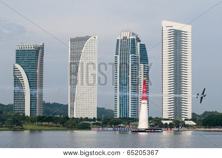 PUTRAJAYA, MALAYSIA - MAY 17, 2014: Hannes Arch from Austria in an Edge 540 V3 plane flies through the race course over Putrajaya lake at the Red Bull Air Race World Championship 2014.