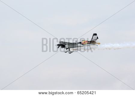 PUTRAJAYA, MALAYSIA - MAY 17, 2014: Michael Goulian of USA, in an Edge 540 V2 plane takes to the skies duirng the qualifying session of the Red Bull Air Race World Championship 2014.