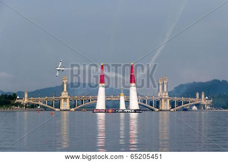 PUTRAJAYA, MALAYSIA - MAY 17, 2014: Martin Sonka from the Czech Republic in an Edge 540 V3 plane enters the race course at the Red Bull Air Race World Championship 2014 in Putrajaya.