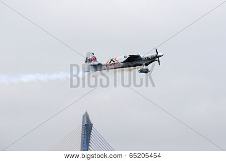 PUTRAJAYA, MALAYSIA - MAY 17, 2014: World champion Hannes Arch from Austria, in an Edge 540 V3 plane flies in the skies of Putrajaya, Malaysia at the Red Bull Air Race World Championship.