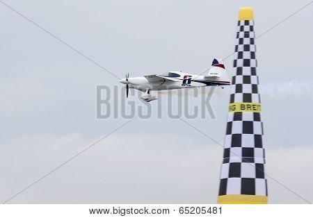 PUTRAJAYA, MALAYSIA - MAY 17, 2014: Martin Sonka from the Czech Republic in an Edge 540 V3 plane flies through the race course over Putrajaya lake at the Red Bull Air Race World Championship 2014.