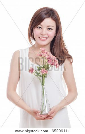 Asian Woman Holding Flowers In A Vase