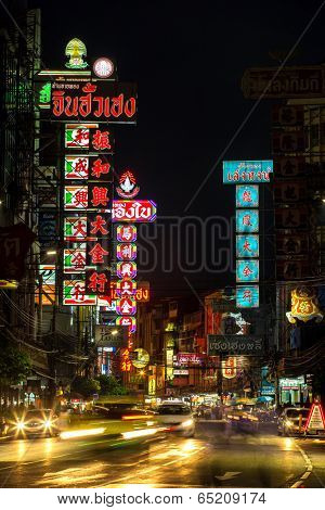 BANGKOK - APRIL 17: Neon shop signs at Yaowarat Road in the evening on April 17, 2014 in Bangkok. Yaowarat Road is a main street in Bangkok's Chinatown.