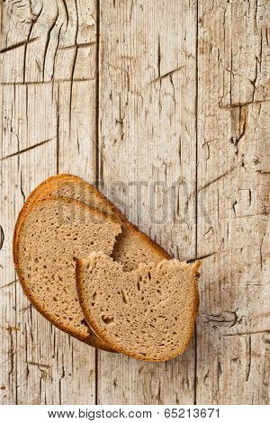 slices of rye bread on rustic wooden background