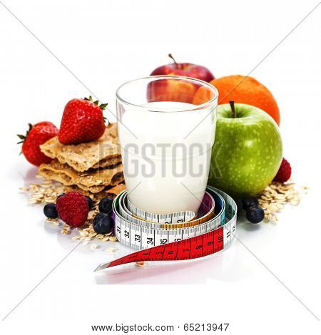 Glass of milk or  kefir, fruits, crispbreads, berries and measuring tape isolated on white