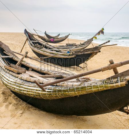 Old fisherman boats on the beach in Hue province, Vietnam