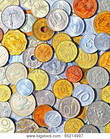 Background Of Many Metallic Coins Of Different Countries