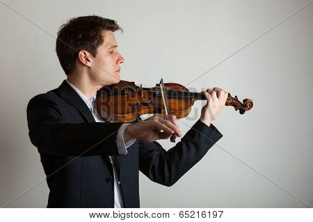 Man Violinist Playing Violin. Classical Music Art