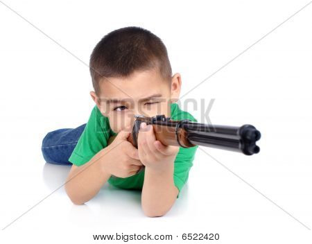 Kid pointing a gun