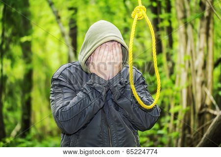 Man near noose in the woods