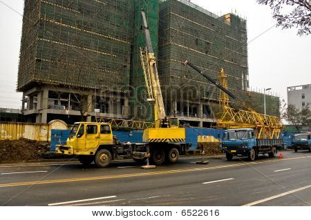 Telescopic Cranes Are Lifting Heavy Weight On Construction Site.