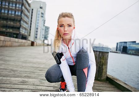 Female Jogger Preparing For Second Run
